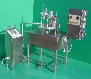JUNIOR Rotary cup filler with Uniflux Tirol bottle filler